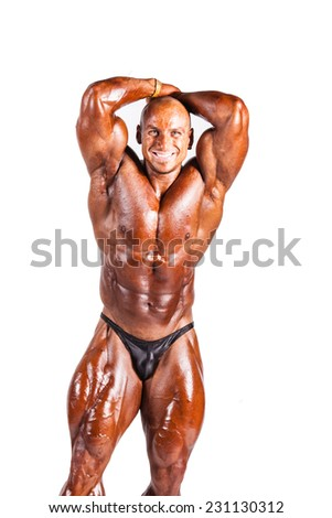 bodybuilder flexing his muscles isolated white - stock photo