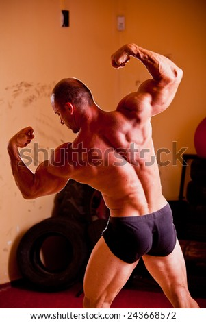 Bodybuilder in a gym - stock photo