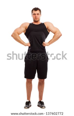 Bodybuilder in fitwear posing isolated  over white background - stock photo