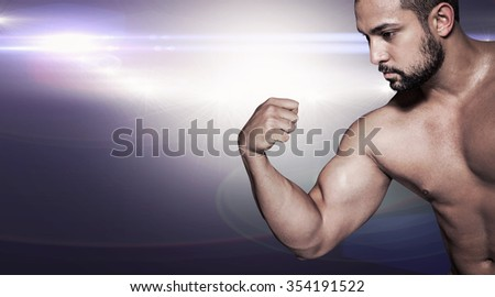 Bodybuilder man flexing his muscles against lens flare
