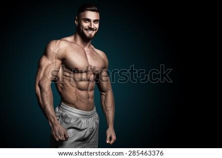 bodybuilder on a black background - stock photo