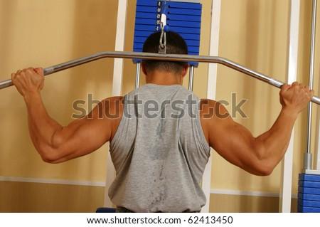 bodybuilder on the simulator - stock photo