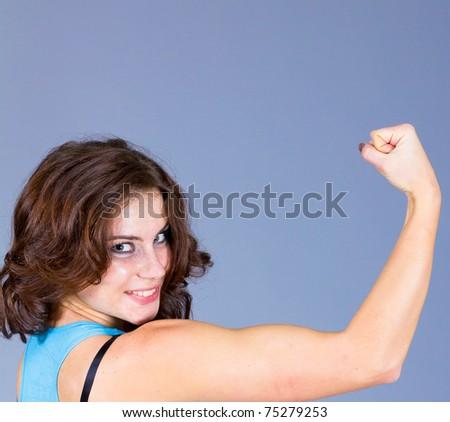 Bodybuilder Posing Female - stock photo