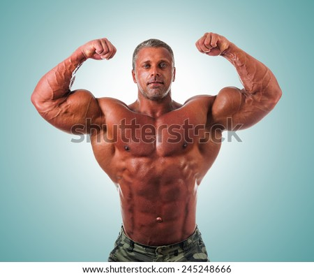 bodybuilder posing. Handsome power athletic guy male. Fitness muscular body.