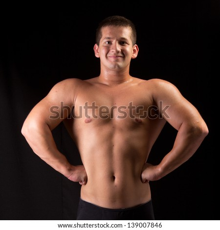 Bodybuilder posing in off season shape - stock photo