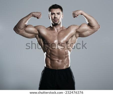 Bodybuilder posing in the studio  - stock photo