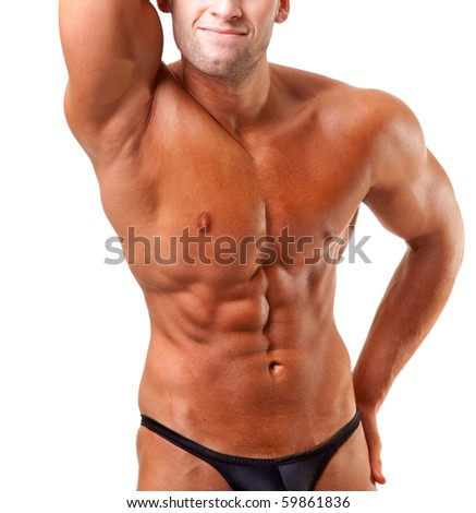 bodybuilder posing-show his abs - stock photo