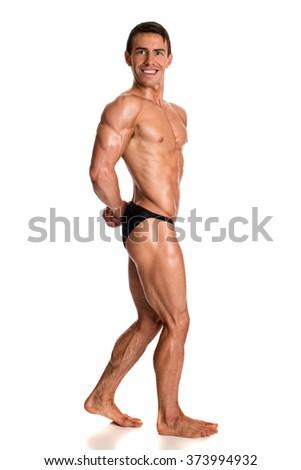 Bodybuilder posing. Studio shot on white. - stock photo