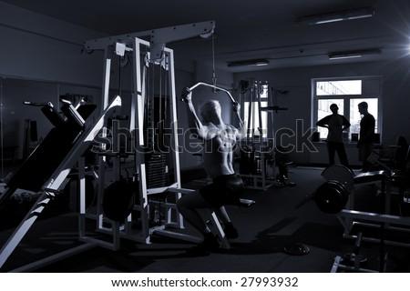 Bodybuilder's training in the gym - stock photo