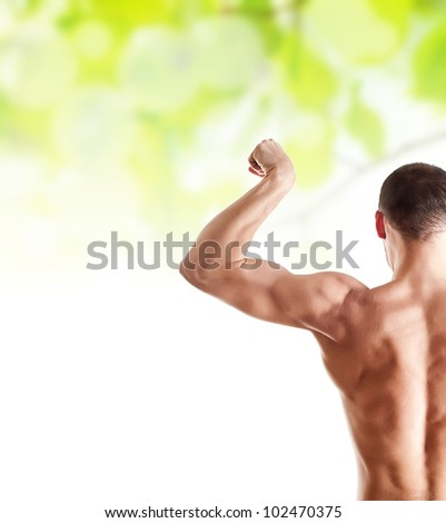 bodybuilder showing his biceps over green spring healthcare background