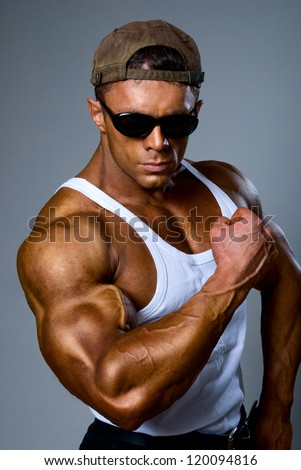 Bodybuilder strong athletic man show muscle arm, sport guy showing his male muscles - stock photo