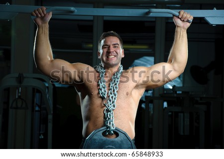 Bodybuilder training in gym - stock photo