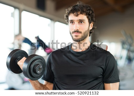 Bodybuilder using a dumbbell to work out