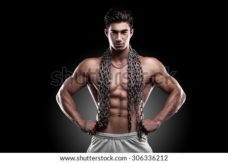 bodybuilder with a chain on a black background
