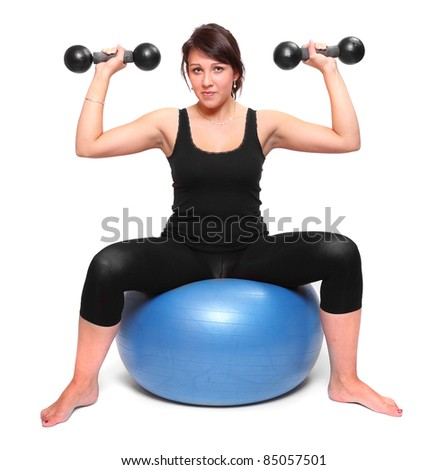 Bodybuilder woman exercising and working out with dumbells.
