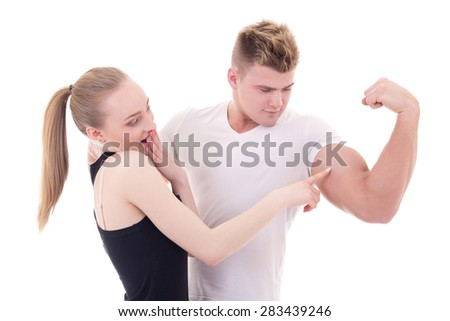 bodybuilding concept - muscular man showing his muscles to excited girlfriend isolated on white background - stock photo