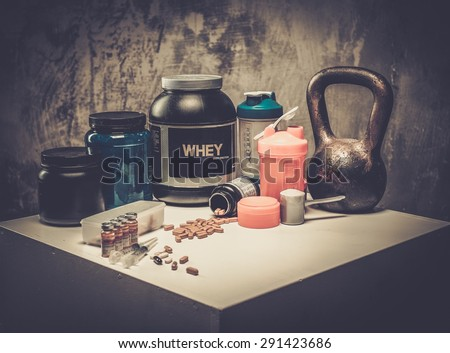 Bodybuilding nutrition supplements and chemistry  - stock photo