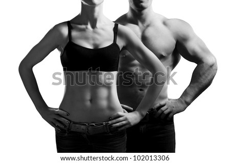 Bodybuilding. Strong man and a woman posing. Isolated on white background - stock photo