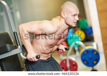 bodybuiler man at gym have a workout