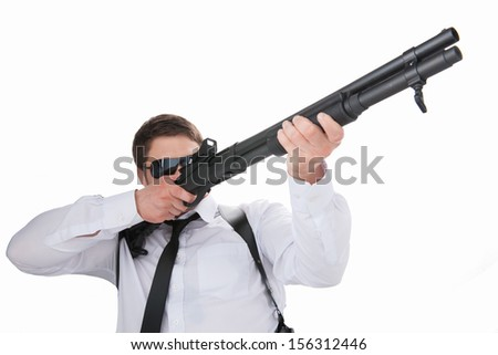 Bodyguard. Low angle view of confident young man in shirt and tie aiming with gun while standing isolated on white - stock photo