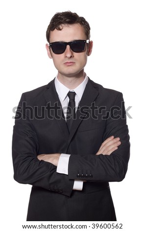 bodyguard with glasses and folded arms, isolated on white - stock photo