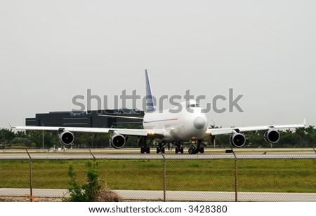 Boeing 747 jumbo jet carrying cargo - stock photo