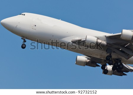 Boeing 747 with blue sky in background - stock photo