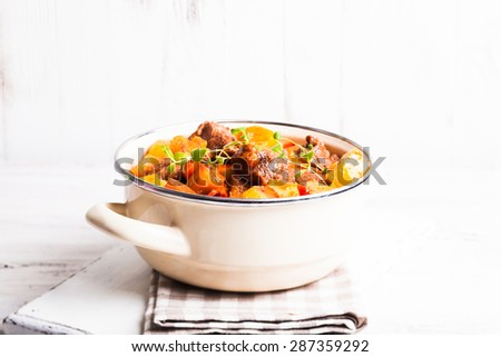 Boeuf Bourguignon - stewed meat with vegetables in casserole - stock photo