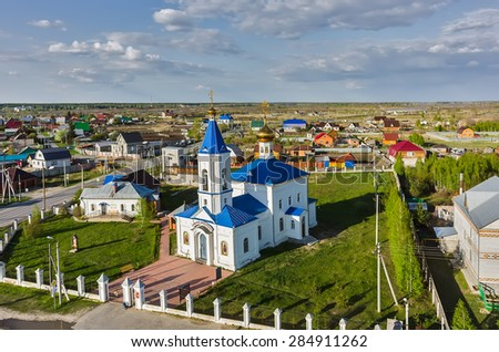 Bogandinskoe (Kilki), Russia - May 13, 2015: Aerial view on Sacred and Ilyinsky temple from helicopter.Tyumen region - stock photo