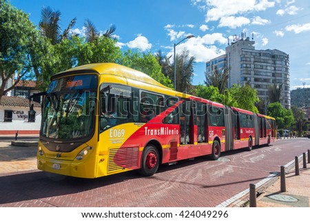 BOGOTA, COLOMBIA - APRIL 21: Transmilenio bus passes through downtown Bogota, Colombia on April 21, 2016 - stock photo
