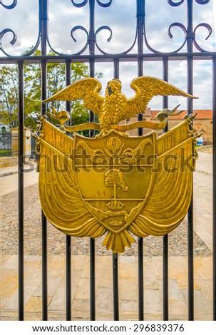 BOGOTA, COLOMBIA - FEBRUARY 9, 2015:Golden coat of arms of Colombia, in a gate of the Presidential residence, House of Narino, Bogota