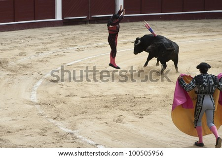BOGOTA - JANUARY 18:An unidentified Colombian bullfighter performs in the Plaza de Toros on January 18,2009 in Bogota, Colombia.The popular bullfighting competition is held annually in Plaza de Toros. - stock photo