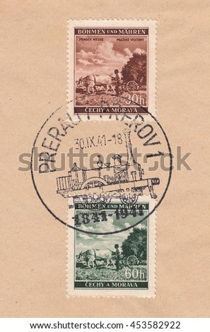 BOHEMIA and MORAVIA-CIRCA 1941:A stamp printed in Czechia,shows Agriculture, Prague fair.Postmark of the city of Prerov steam locomotive,circa 1941. - stock photo