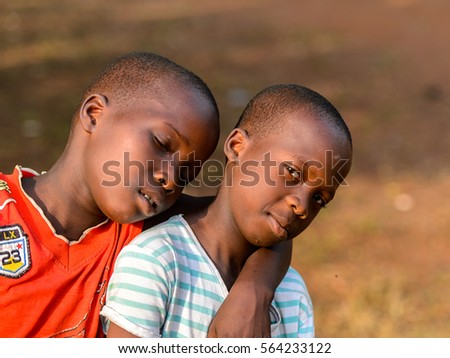 BOHICON, BENIN - JAN 11, 2017: Unidentified Beninese boy hugs his friend. Benin children suffer of poverty due to the bad economy.