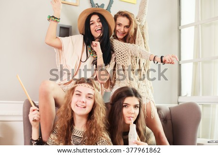 Boho style girl at home party - stock photo