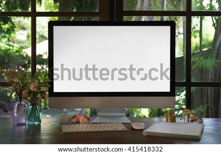 Boho style workplace. The monitor on a desk mockup scene over window. The working surface of the computer. Roses flowers, summertime, work at home concept. - stock photo