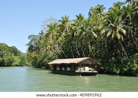 Bohol, Philippines - June 23, 2014: One of floating restaurants cruising the Loboc River in Bohol.