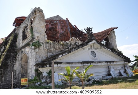 Bohol, Philippines - June 23, 2014: Santissima Trinidad Parish church in  Loay, Bohol, Philippines that was damaged after a 7.2-magnitude earthquake hit the province on October 15, 2013.  - stock photo