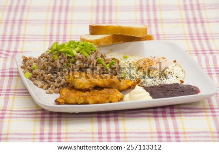 Boiled buckwheat with meat steaks, fried egg omelet with white and acid sauces, white bread recipe