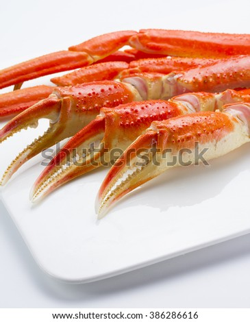 Boiled crab claws over white background  - stock photo