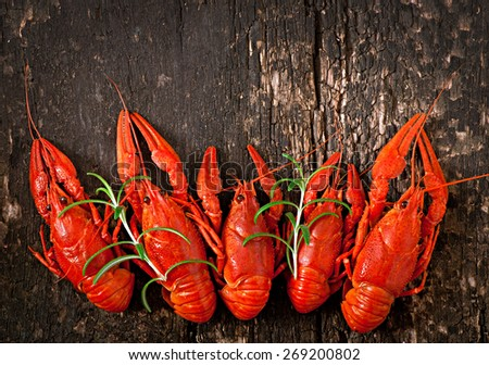 Boiled crawfish on a wooden background. Top view - stock photo