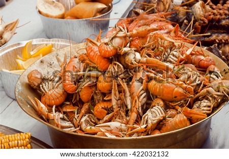 Boiled crawfish ready to eat in the kitchen of a seafood restaurant - stock photo