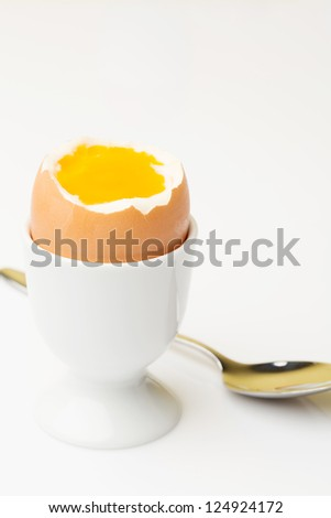 Boiled egg in an egg cup - stock photo
