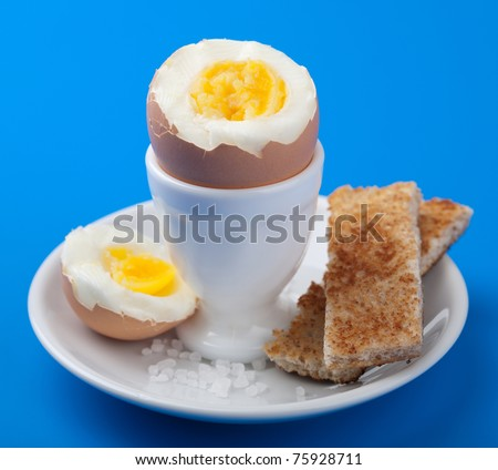 boiled egg in egg cup - stock photo