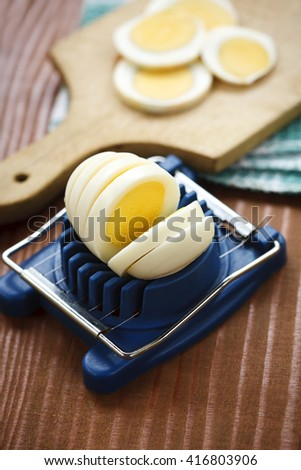 boiled egg sliced on the board - stock photo