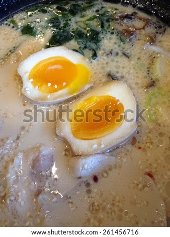 boiled egg topping on noodle soup - stock photo