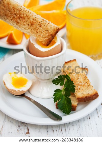 boiled eggs for breakfast on a old wooden table - stock photo