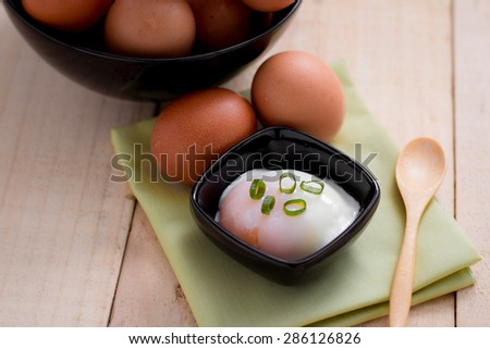 boiled eggs for breakfast on wooden table. - stock photo