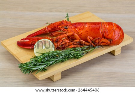 Boiled lobster served with thyme and rosemary - stock photo