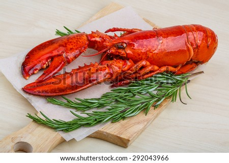 Boiled lobster with rosemary on the wood background - stock photo